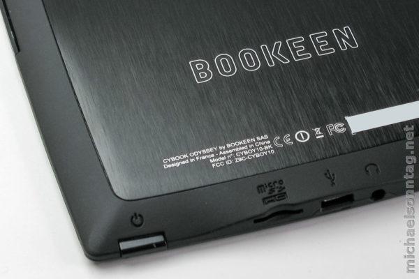 Cybook Odyssey - Rückseite mit Einschalttaste, MicroSD-Schacht, Micro-USB-Anschluss und Kopfhörereingang